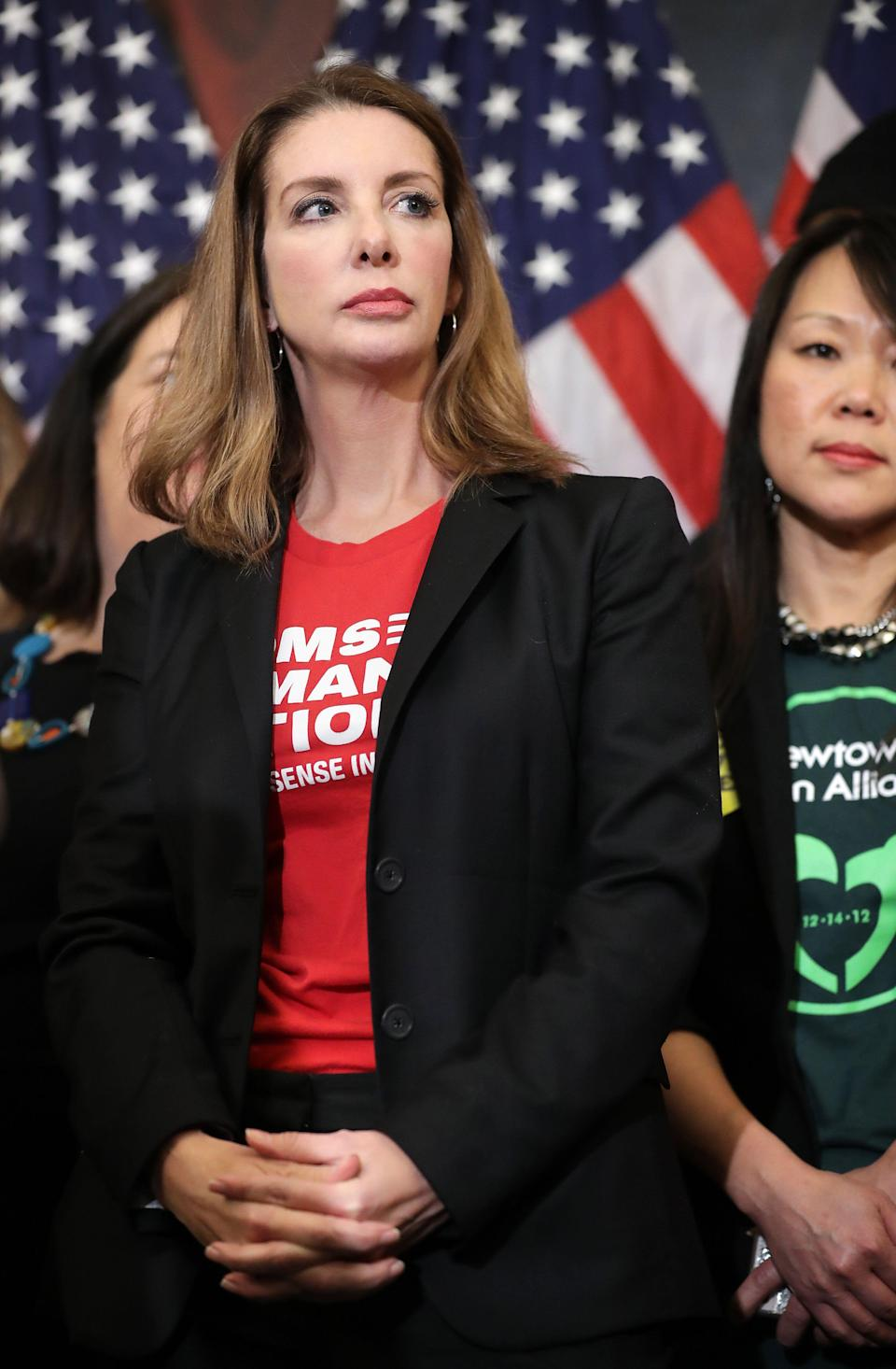 WASHINGTON, DC - JANUARY 08: Founder of Moms Demand Action for Gun Sense founder Shannon Watts  joins other gun safety advocates for a news conference to introduce legislation to expand background checks for firearm sales in the Rayburn Room of the U.S. Capitol January 08, 2019 in Washington, DC. Eight years to the day that Giffords was shot at a constituent meeting in Tuscon, Arizona, Speaker Nancy Pelosi (D-CA) unveiled a universal background check bill that House Democrats hope to pass within the first 100 days of the new Congress.   (Photo by Chip Somodevilla/Getty Images)