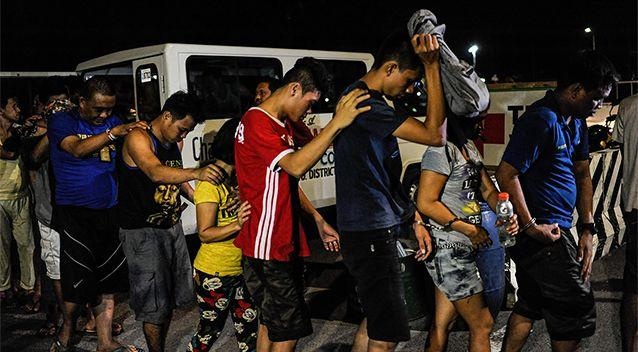 Suspected drug users and drug dealers are arrested by police during a night time raid on a suspected drug den  on June 16, 2016 in Manila. Photo: Getty Images/Dondi Tawatao