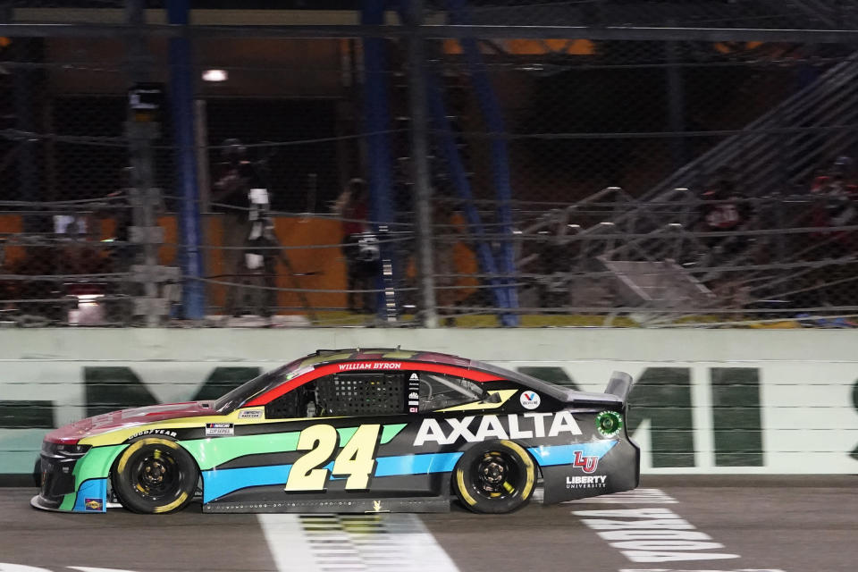 William Byron crosses the finish line to win a NASCAR Cup Series auto race, Sunday, Feb. 28, 2021, in Homestead, Fla. (AP Photo/Wilfredo Lee)