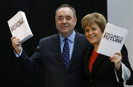 Scotland's First Minister Alex Salmond and deputy First Minister Nicola Sturgeon hold copies of the referendum white paper on independence during its launch in Glasgow, Scotland