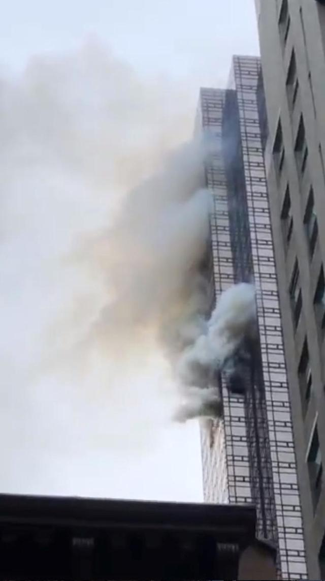 <p>Smoke rises up from Trump Tower in New York, April 7, 2018 in this picture obtained from social media. (Photo: Twitter@brightbazaar/via Reuters) </p>