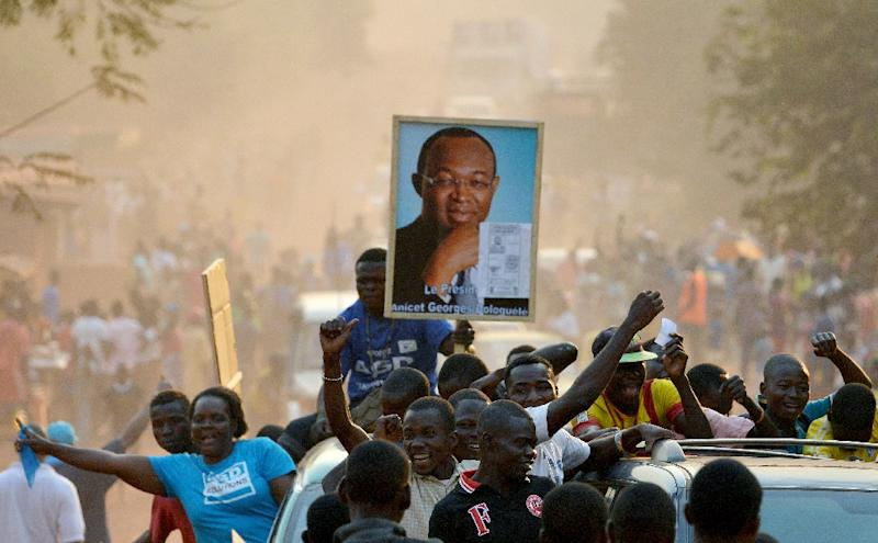Supporters hold a portrait of Central African Republic presidential candidate Anicet Georges Dologuele in Bangui