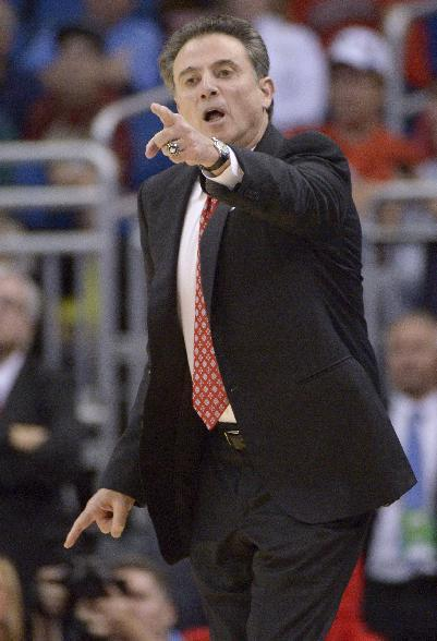 Louisville coach Rick Pitino gestures to his team during the first half against Manhattan in a second-round game in the NCAA college basketball tournament Thursday, March 20, 2014, in Orlando, Fla. (AP Photo/Phelan M. Ebenhack)