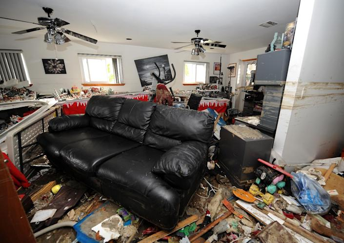 Debris covers the lower floor of Don Durando's house in Long Beach, N.Y. Thursday, Nov. 1, 2012, after sustaining flooding and other damage from Superstorm Sandy. Three days after Sandy slammed the mid-Atlantic and the Northeast, New York and New Jersey struggled to get back on their feet, the U.S. death toll climbed to more than 80, and more than 4.6 million homes and businesses were still without power. (AP Photo/Kathy Kmonicek)