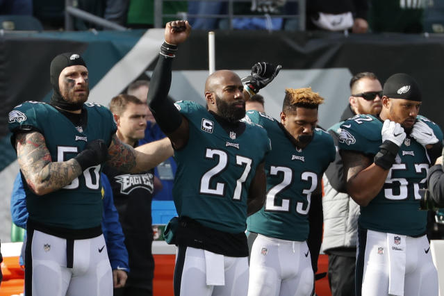 Philadelphia Eagles' Chris Long, from left, Malcolm Jenkins and Rodney McLeod gesture during the national anthem on Sunday. (AP)