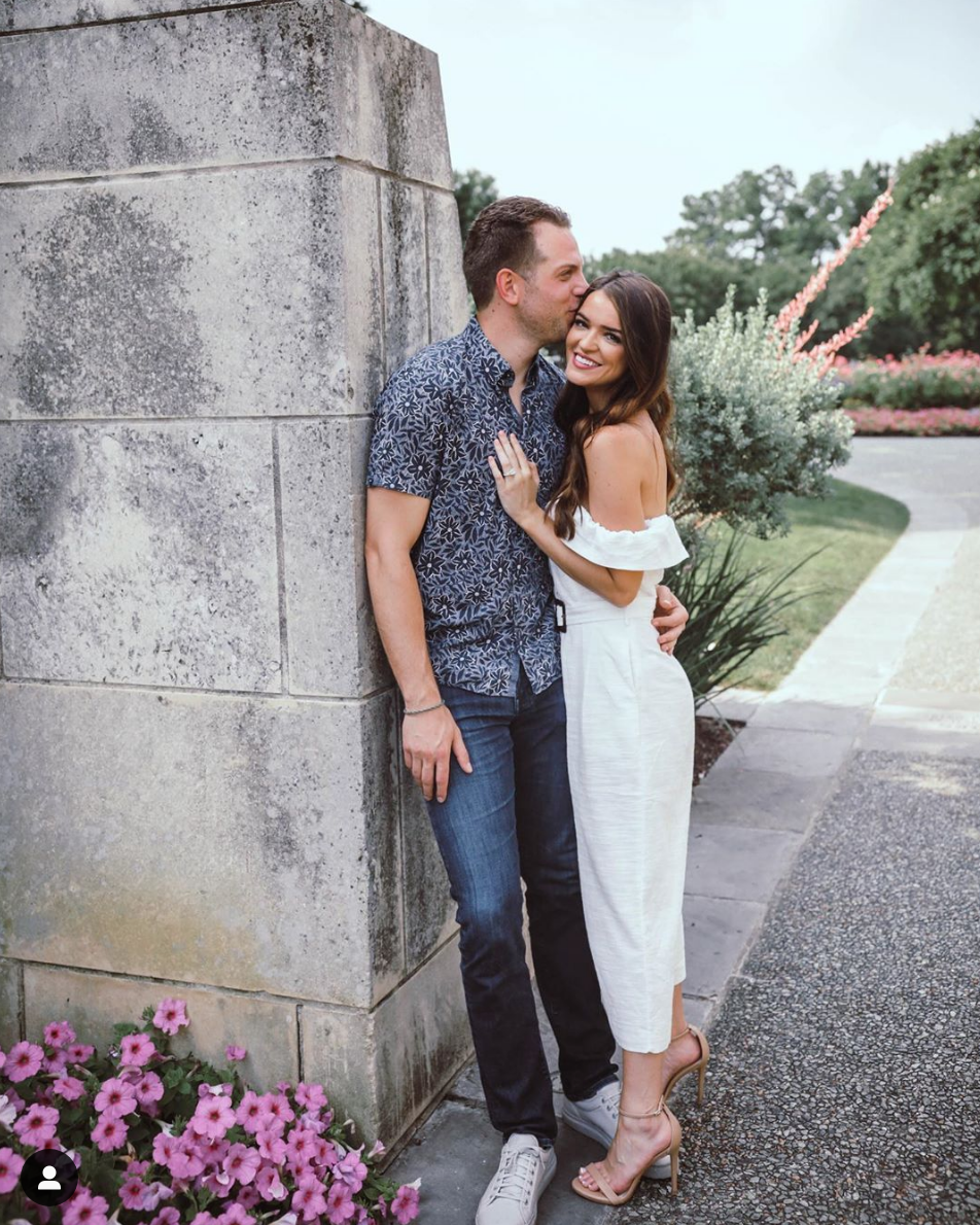 """<p>After two years of dating, Adam popped the question to Raven on a Dallas rooftop. """"I'm keeping you forever and for always We will be together all of our days Wanna wake up every morning to your sweet face...Always,"""" Raven <a href=""""https://www.instagram.com/p/ByONWtZpsVw/"""" rel=""""nofollow noopener"""" target=""""_blank"""" data-ylk=""""slk:wrote on Instagram"""" class=""""link rapid-noclick-resp"""">wrote on Instagram</a>. They've had to reschedule their wedding three times due to the pandemic, but they're still going full steam ahead in their engagement.</p>"""