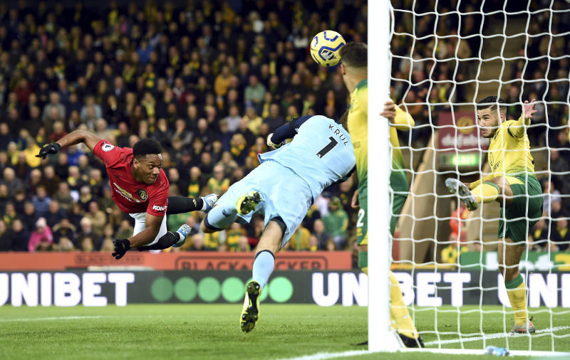 Norwich City goalkeeper Tim Krul saves from Manchester United's Anthony Martial during the Premier League match between Norwich City and Manchester United, at Carrow Road, Norwich, Britain, Sunday, Oct. 27, 2019.  (Joe Giddens/PA via AP)