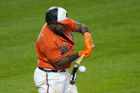 Baltimore Orioles' Maikel Franco breaks his bat while driving in Ryan Mountcastle with a run against the Boston Red Sox during the eighth inning of a baseball game, Saturday, April 10, 2021, in Baltimore. The Red Sox won 6-4 in ten innings. (AP Photo/Julio Cortez)