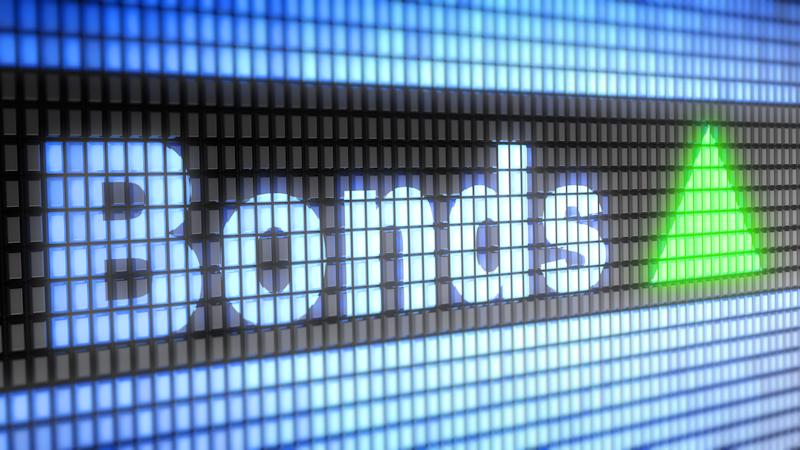 The word Bonds appears on an electric screen with a green triangle next to it.