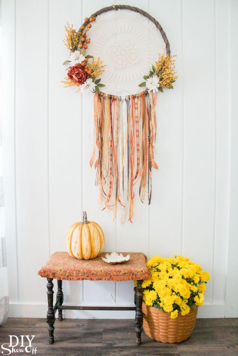 """<p>This dreamy, oversized dreamcatcher works beautifully as an wreath when it's hung in the center of your front door. Keep things grounded with earthy faux flowers. </p><p><strong>Get the tutorial at <a href=""""https://diyshowoff.com/2017/09/11/diy-fall-dreamcatcher-door-wreath-decor-tutorial/"""" rel=""""nofollow noopener"""" target=""""_blank"""" data-ylk=""""slk:DIY Show Off"""" class=""""link rapid-noclick-resp"""">DIY Show Off</a>.</strong></p><p><strong><a class=""""link rapid-noclick-resp"""" href=""""https://www.amazon.com/Best-Sellers-Home-Kitchen-Artificial-Flowers/zgbs/home-garden/14087331?tag=syn-yahoo-20&ascsubtag=%5Bartid%7C10050.g.2063%5Bsrc%7Cyahoo-us"""" rel=""""nofollow noopener"""" target=""""_blank"""" data-ylk=""""slk:SHOP ARTIFICIAL FLOWERS"""">SHOP ARTIFICIAL FLOWERS</a></strong></p>"""