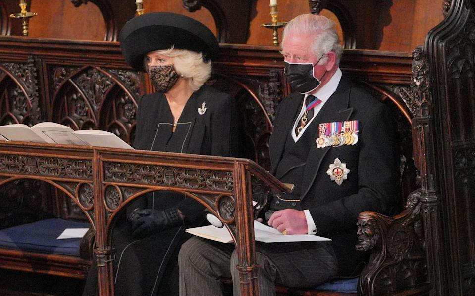 Camilla, Duchess of Cornwall, wore a lace face mask - AFP