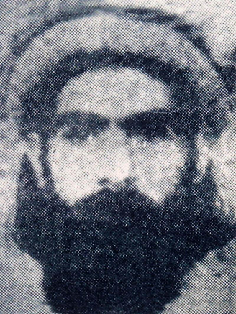 FILE  - This undated file photo reportedly shows the Taliban supreme leader Mullah Omar. Infuriated that Washington met secretly at least three times with a personal emissary of Taliban leader Mullah Mohammed Omar, the Afghan government intentionally leaked details of the clandestine meetings, scuttling the talks and sending the Taliban intermediary into hiding, The Associated Press has learned. (AP Photo/ File)
