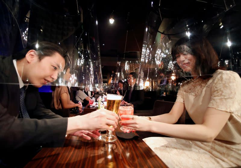 Goldfish bowl-like acrylic screens used as part of new social distancing measures and prevention of infection against the the coronavirus disease (COVID-19) are installed at a night club in Tokyo