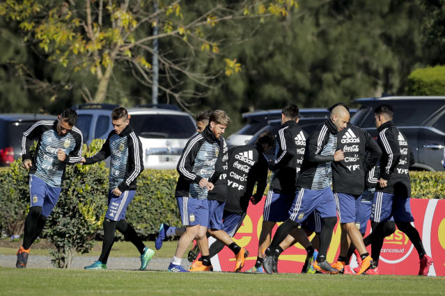 Javier Mascherano, right, Cristian Ansaldi, center, and teammates train with the Argentine national soccer squad in Buenos Aires, Argentina, Wednesday, May 23, 2018. Argentina will face Haiti on May 29 in an international friendly soccer match ahead of the FIFA Russia World Cup. (AP Photo/Victor R. Caivano)