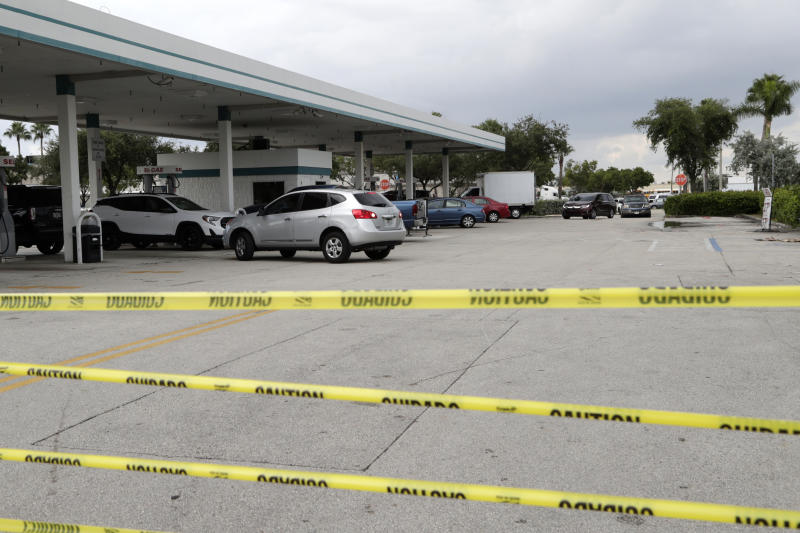 Tape blocks an entrance at BJ's Wholesale Club to control traffic flow as motorists line up for fuel in preparation for Hurricane Dorian, Aug. 29, 2019, in Hialeah, Fla. (Photo: Lynne Sladky/AP)