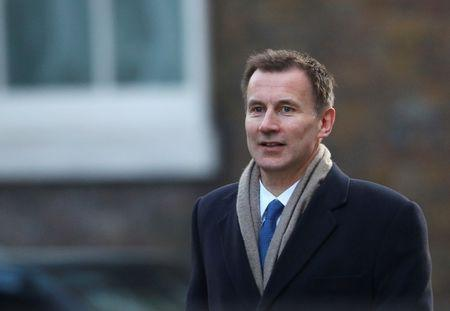 Britain's Secretary of State for Health and Social Care Jeremy Hunt arrives in Downing Street in London, February 6, 2018. REUTERS/Hannah McKay/File Photo