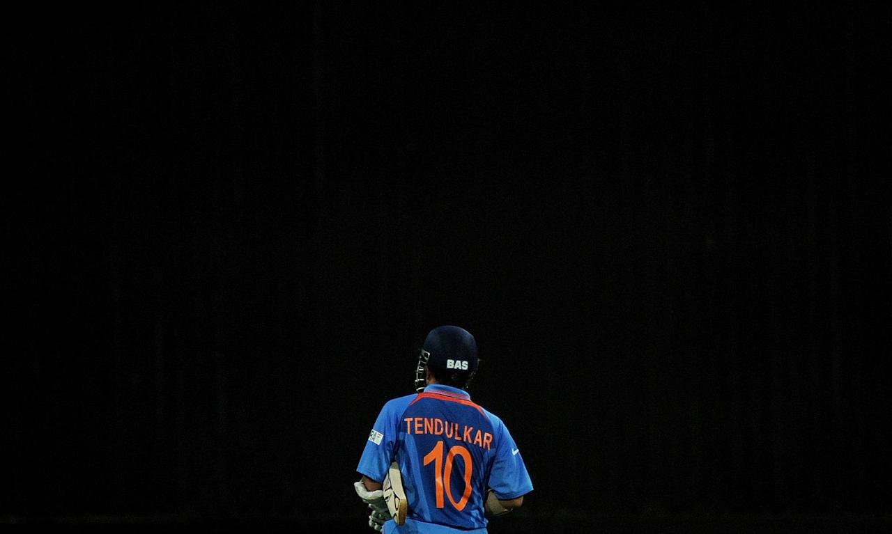 (FILES) This April 2, 2011 file photograph shows Indian cricket star Sachin Tendulkar as he walks back to the pavilion after his dismissal during the ICC Cricket World Cup 2011 Final match at The Wankhede Stadium in Mumbai. On March 16, 2012 Indian batting superstar Sachin Tendulkar became the first cricketer in history to score 100 international centuries, reaching a new record in his glittering two-decade career.  AFP PHOTO/MANAN VATSYAYANA (Photo credit should read MANAN VATSYAYANA/AFP/Getty Images)