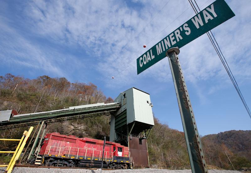 A road sign is posted at the entranced the closed Spruce Creek coal mine in Matewan, W.Va., Friday, Nov. 11, 2016. The hard-eyed view along the Tug Fork River in coal country is that Donald Trump has to prove he'll help Appalachian mining like he promised. (AP Photo/Steve Helber)