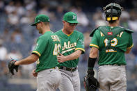 Oakland Athletics manager Bob Melvin, center, relieves relief pitcher Burch Smith (46) in the seventh inning of a baseball game against the New York Yankees, Saturday, June 19, 2021, in New York. (AP Photo/John Minchillo)