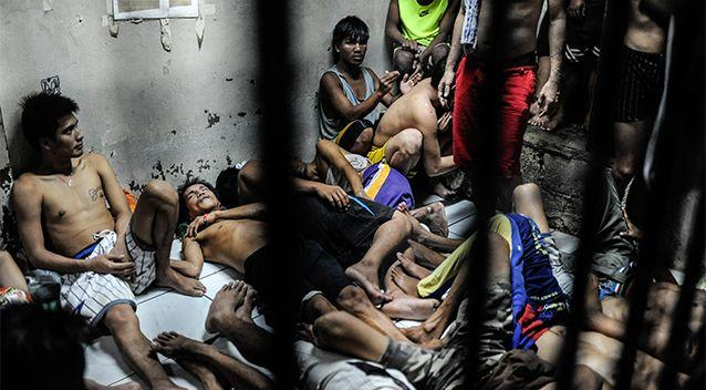 Criminals with various offenses and drug gangs sit in an overcrowded jail cell on June 20, 2016 in Manila, Philippines. Photo: Getty Images/Dondi Tawatao