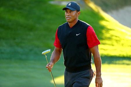 FILE PHOTO: Nov 23, 2018; Las Vegas, NV, USA; Tiger Woods reacts to his putt on on the 14th green during The Match: Tiger vs Phil golf match at Shadow Creek Golf Course. Mandatory Credit: Rob Schumacher-USA TODAY Sports
