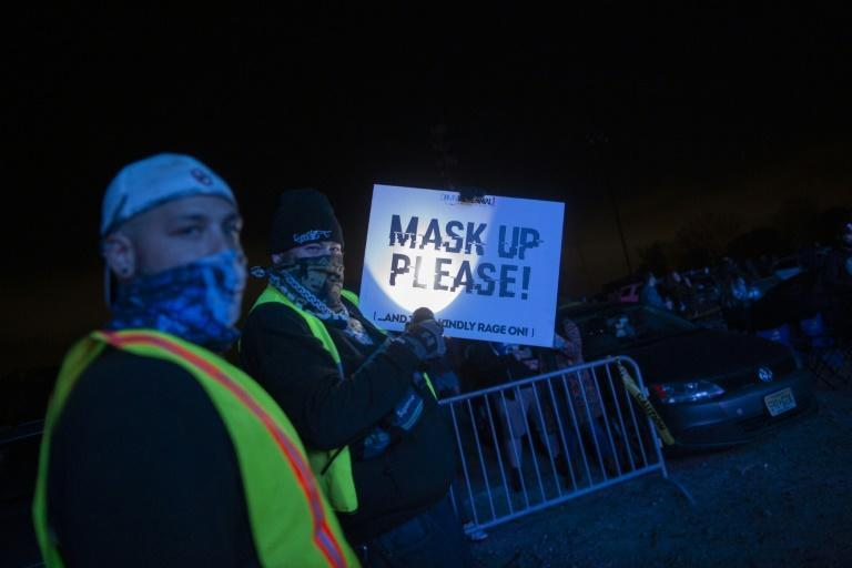 Security guards remind party-goers to keep their masks on
