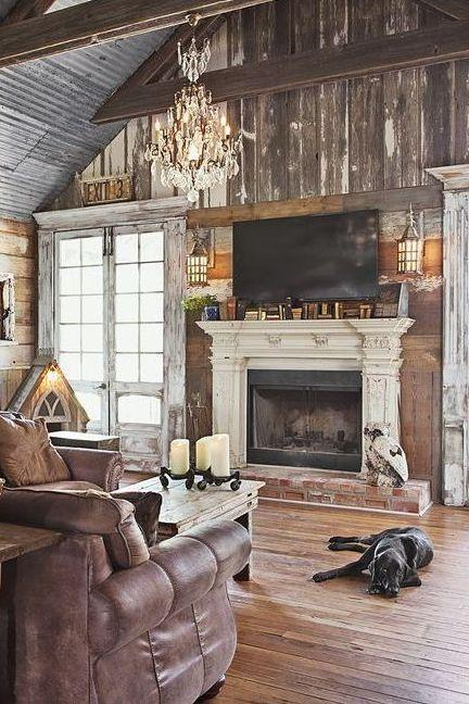 <p>Exercise the principle of symmetry by opting for a pair of metal lamps above your fireplace. It's a great way to bring more light into your space, which is necessary during the fall months. </p>