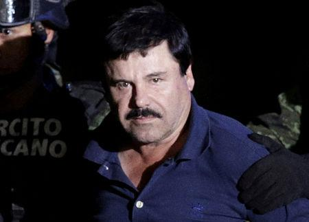 """FILE PHOTO: FILE PHOTO: Recaptured drug lord Joaquin """"El Chapo"""" Guzman is escorted by soldiers at the hangar belonging to the office of the Attorney General in Mexico City"""