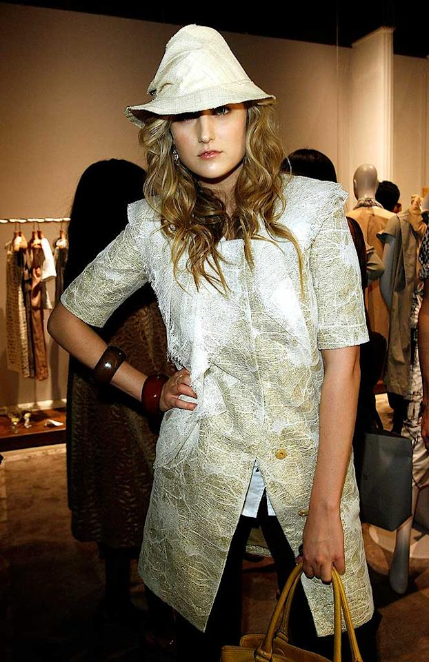 "Speaking of scary ensembles, Leelee Sobieski (""Joy Ride"") unsuccessfully attempts to rock a crushed metallic hat and matching top. Even the Tin Man wouldn't approve! Donato Sardella/<a href=""http://www.wireimage.com"" target=""new"">WireImage.com</a> - April 9, 2008"