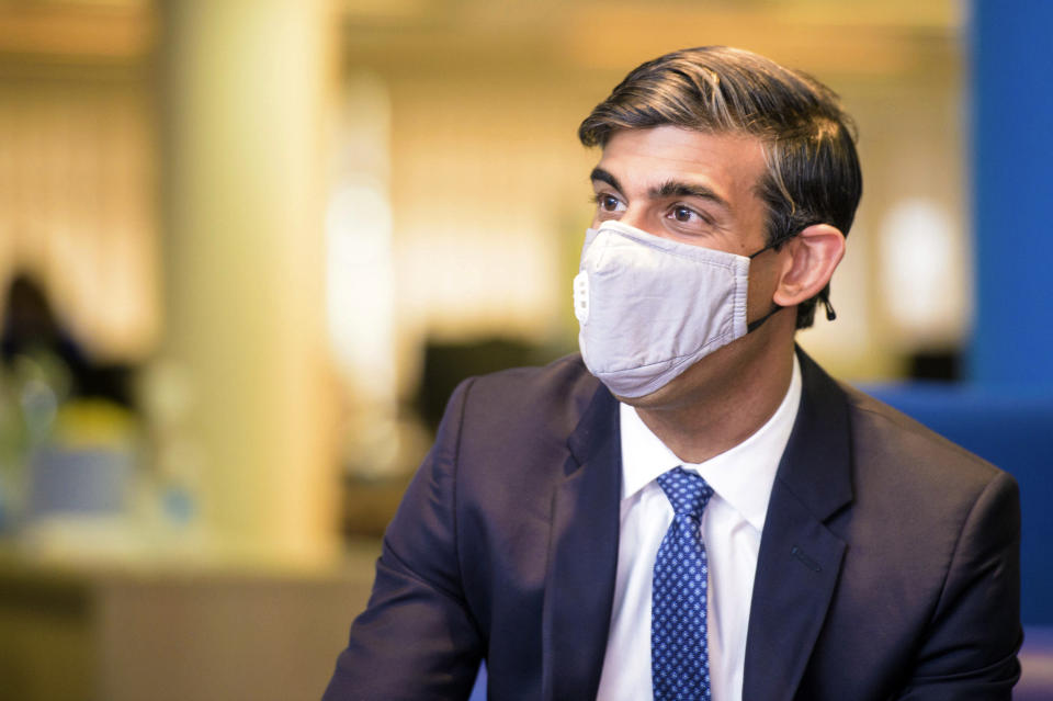 Britain's Chancellor of Exchequer Rishi Sunak wearing a face mask visits the Jobcentre Plus in east London, Thursday July 16, 2020, to see the new support being provided in job centres, as part of the Government's Plan for Jobs. (Anthony Upton/Pool via AP)