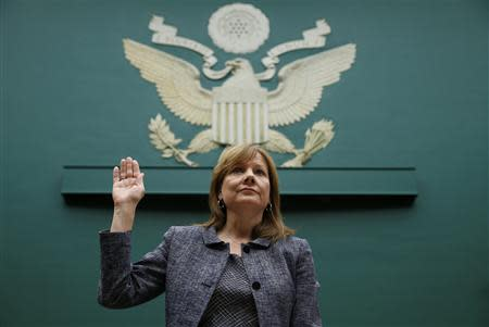 General Motors (GM) Chief Executive Mary Barra (C) is sworn in prior to testifying before a House Energy and Commerce Committee hearing on GM's recall of defective ignition switches, on Capitol Hill in Washington April 1, 2014. REUTERS/Kevin Lamarque