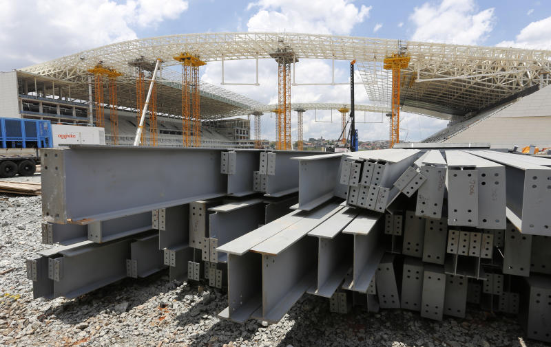 Steel beams sit outside the Arena de Sao Paulo in Sao Paulo, Brazil, Sunday, Dec. 8, 2013. Six matches of the 2014 soccer World Cup will be played in Sao Paulo. (AP Photo/Ferdinand Ostrop)