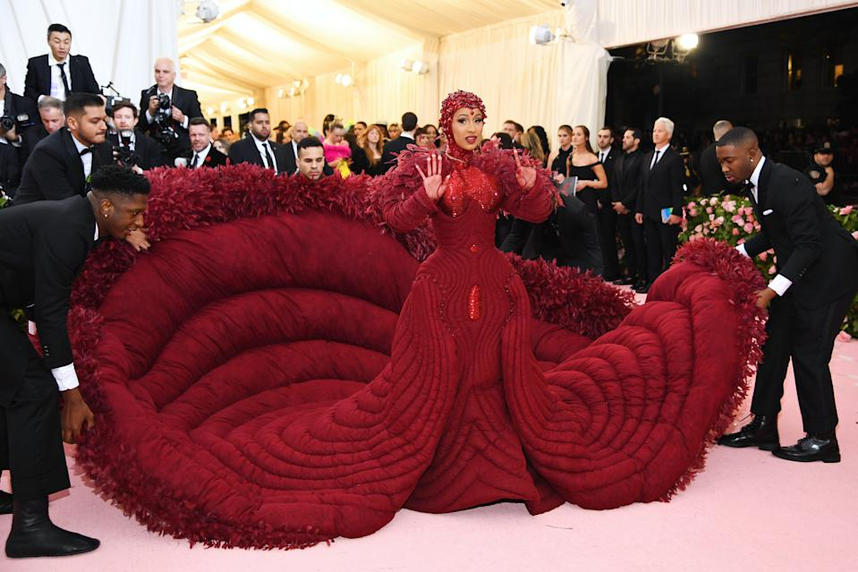 Cardi B pulled off perhaps the most dramatic look of the night in an unforgettable crimson gown, by designer Thom Brown, which was hallmarked by its quilt-like train and matching headpiece. Photo: Getty Images