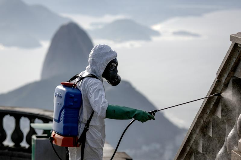 RIO DE JANEIRO, BRAZIL - AUGUST 13: A military personnel belonging to the East Joint Command wearing PPE disinfects the Sanctuary where the statue of Christ the Redeemer is located on August 13, 2020, in Rio de Janeiro, Brazil. The measure is part of a series of government actions to reopen the main tourist spots in the city, banned since the beginning of the coronavirus pandemic (COVID-19) in Brazil. (Photo by Andre Coelho/Getty Images)