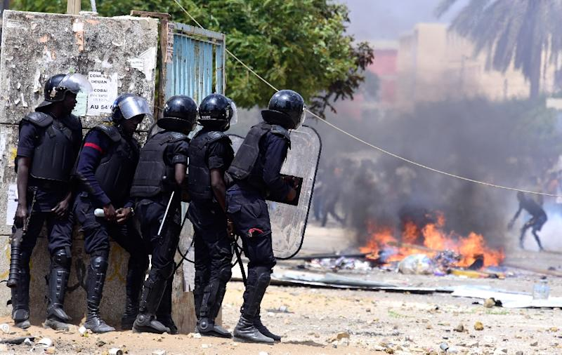 Senegalese police confront students during protests at the University Cheikh Anta Diop in Dakar on Wednesday (AFP Photo/SEYLLOU)