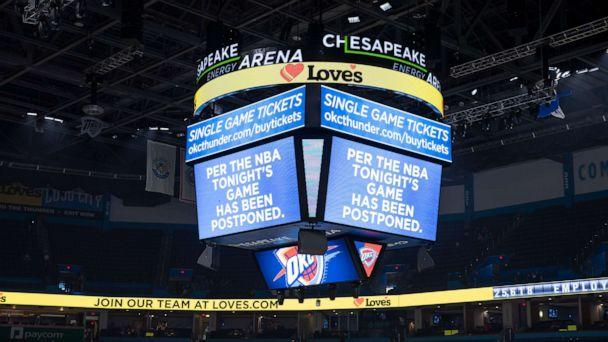 PHOTO: A message on the video score board informs fans the Oklahoma City Thunder game against the Utah Jazz on March 11, 2020, has been postponed. Teams were told to go to the locker rooms just before tip off at Chesapeake Energy Arena.  (Alonzo Adams/USA TODAY Sports)