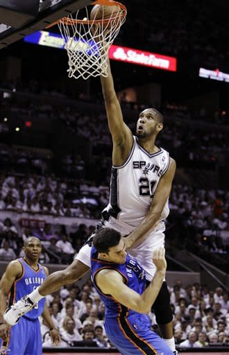 San Antonio Spurs center Tim Duncan (21) is called for a charge against Oklahoma City Thunder power forward Nick Collison (4) during the first half of Game 5 in the NBA basketball Western Conference finals, Monday, June 4, 2012, in San Antonio. (AP Photo/Eric Gay)