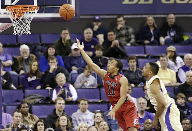 Utah's Brandon Taylor (11) puts a shot up in front of Washington's Darin Johnson during the first half of an NCAA college basketball game Wednesday, Jan. 8, 2014, in Seattle. (AP Photo/Elaine Thompson)