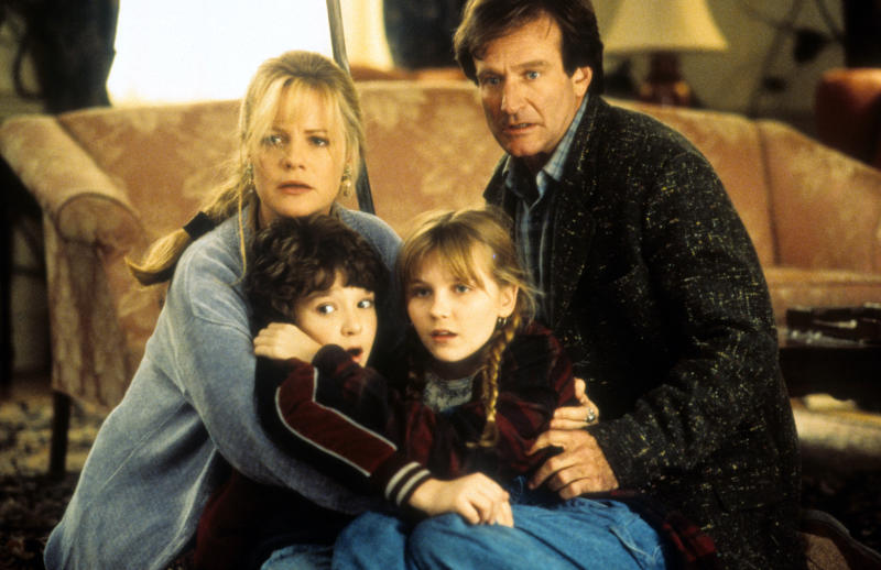 Bonnie Hunt, Bradley Pierce, Kirsten Dunst and Robin Williams hold each other in a scene from the film 'Jumanji', 1995. (Photo by TriStar/Getty Images)