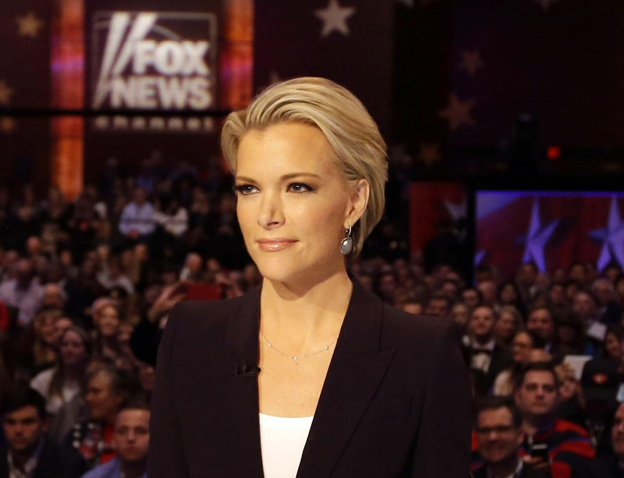 FILE - In this Jan. 28, 2016 photo, Moderator Megyn Kelly waits for the start of the Republican presidential primary debate in Des Moines, Iowa. On July 19, New York magazine reported that Kelly told investigators that her boss, Roger Ailes made unwanted sexual advances to her ten years ago. A lawyer for Ailes later denied that he sexually harassed Kelly. On July 21, Ailes resigned from his position. (AP Photo/Chris Carlson, File)
