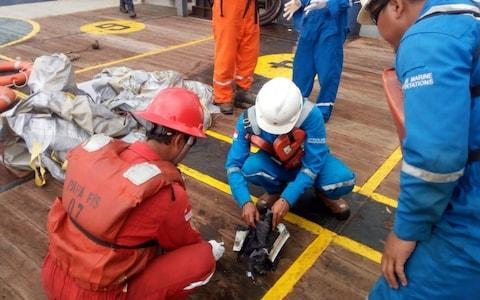 Items believed to be from the wreckage of the Lion Air flight - Credit: AFP