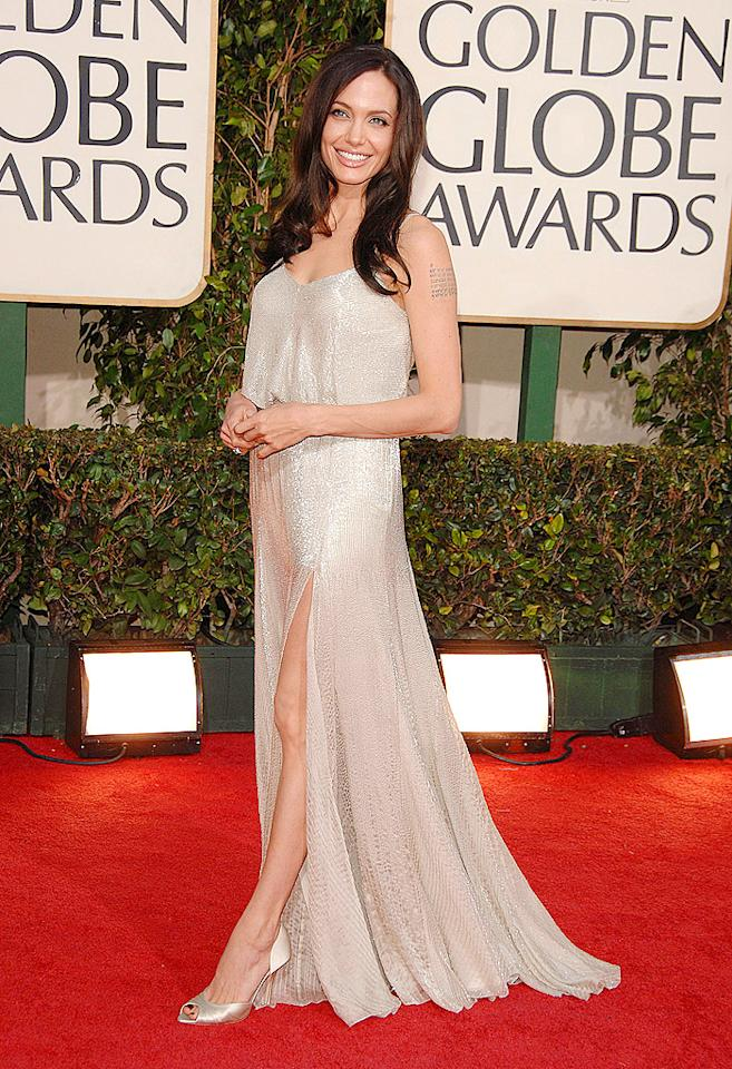 At first glance, Angelina looked downright demure in her sparkling Atelier Versace dress and minimalist makeup at the 2009 Golden Globes. That all changed, of course, once she posed so that we could see one of her stems peeking through. (1/11/2009)