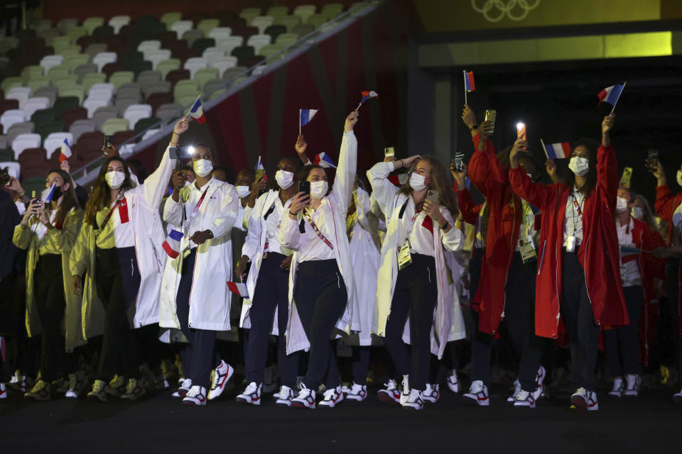 Members of Team France arrives during the opening ceremony in the Olympic Stadium at the 2020 Summer Olympics, Friday, July 23, 2021, in Tokyo, Japan. (Hannah McKay/Pool Photo via AP)