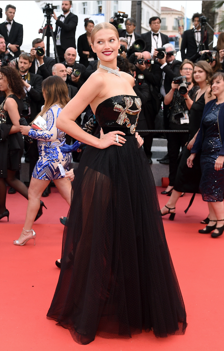 <p>Toni Garrn made her second Cannes appearance in a stunning emboridered bodice gown from Elie Saab's autumn/winter 2018 collection. She wore the look with Messika jewellery.<br> [Photo: Getty] </p>