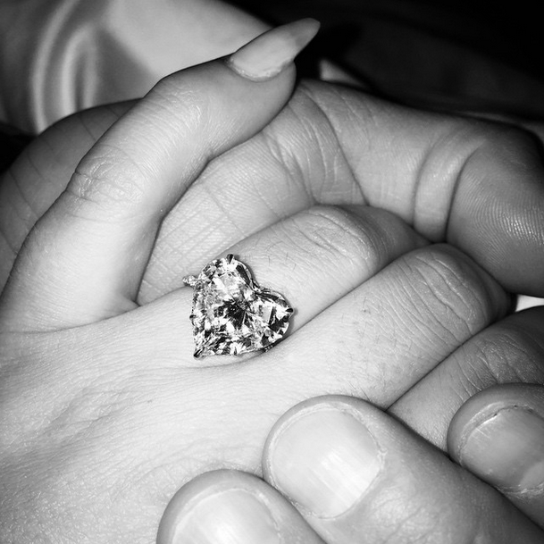 The singer told her 5.4 million Instagram followers that she was engaged on Monday by sharing this photo of her heart-shaped diamond ring. Now Yahoo Style imagines what she would wear on her wedding day to match the massive rock…