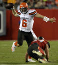 Cleveland Browns quarterback Baker Mayfield (6) eludes a tackle by Tampa Bay Buccaneers linebacker Carl Nassib (94) during the first half of an NFL preseason football game Friday, Aug. 23, 2019, in Tampa, Fla. (AP Photo/Jason Behnken)