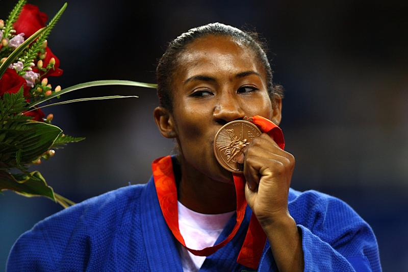 BEIJING - AUGUST 11: Ketleyn Quadros of Brazil celebrates after winning the bronze medal in the Women's 57 kg Judo event at the University of Science and Technology Beijing Gymnasium on Day 3 of the Beijing 2008 Olympic Games on August 11, 2008 in Beijing, China. (Photo by Paul Gilham/Getty Images)