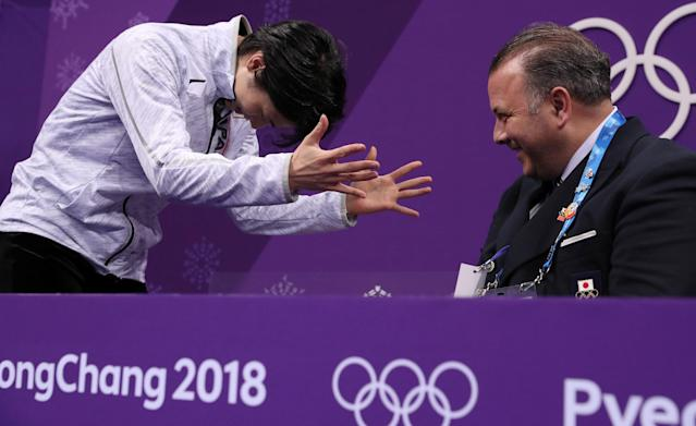 Figure Skating - Pyeongchang 2018 Winter Olympics - Men Single free skating competition final - Gangneung, South Korea - February 17, 2018 - Yuzuru Hanyu of Japan gestures to his coach Brian Orser after hearing his score. REUTERS/Damir Sagolj TPX IMAGES OF THE DAY