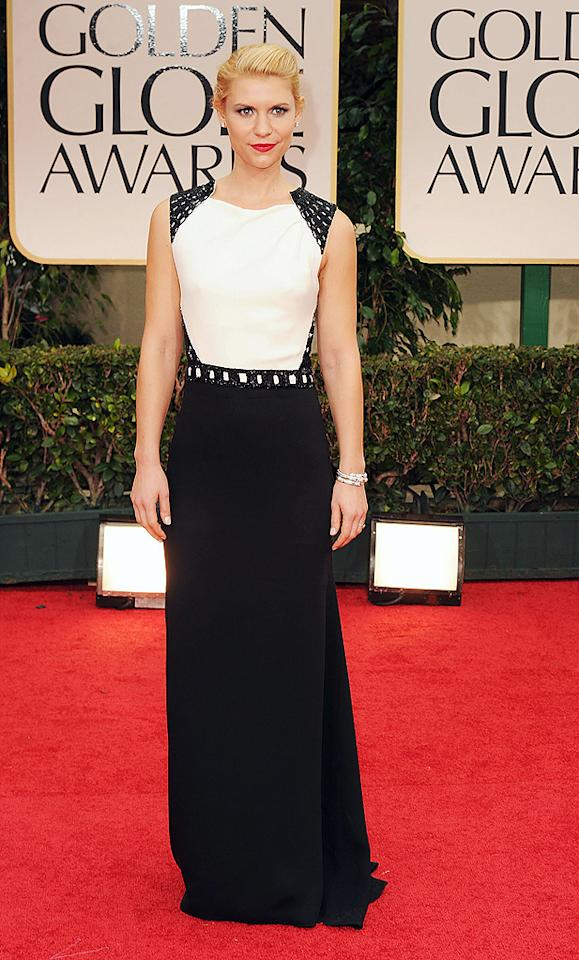 """<strong>Claire Danes</strong><br><strong>Grade: A-<br></strong>  <p class=""""MsoNormal""""><span>Best Actress winner Claire Danes (""""Homeland"""") was the epitome of sophistication in her J. Mendel gown, which featured a sexy cut-out back. Bulgari jewels completed her ensemble.</span></p>  <br><strong><br><br></strong>"""