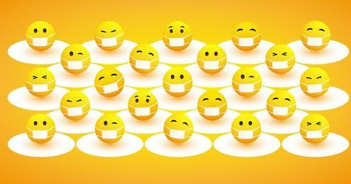 """<span class=""""caption"""">The emoji with the medical mask has become synonymous with COVID-19.</span> <span class=""""attribution""""><a class=""""link rapid-noclick-resp"""" href=""""https://www.shutterstock.com/image-vector/protect-yourself-keep-your-social-distancing-1683929149"""" rel=""""nofollow noopener"""" target=""""_blank"""" data-ylk=""""slk:Jozsef Bagota/Shutterstock"""">Jozsef Bagota/Shutterstock</a></span>"""